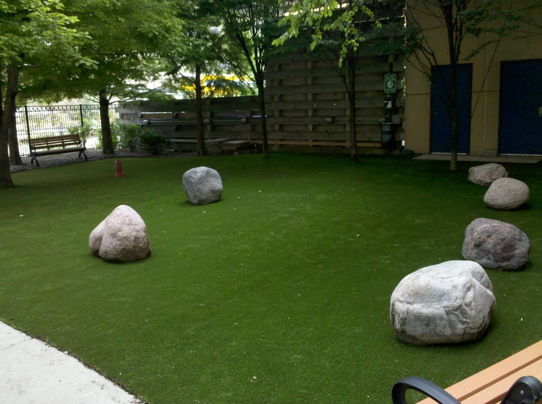 Some stones arranged in a Petgrass dog park.