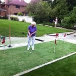 Grandma enjoying a Perfect Turf Synthetic Turf Putting Green