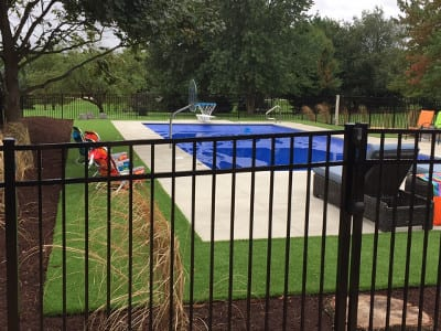 Pool Surrounded by Synthetic Turf - Pool Surrounds Photo